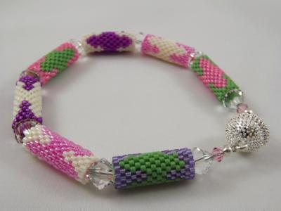 B-33 pink, purple, ivory, & green bead tube bracelet
