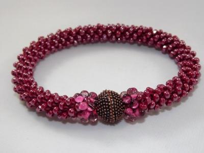 B-64 sparkling magenta crocheted rope bracelet