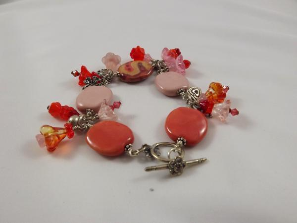 B-4 coral kazuri bead & flower charm bracelet