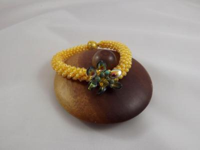B-110 golden yellow crocheted rope bracelet w/flower