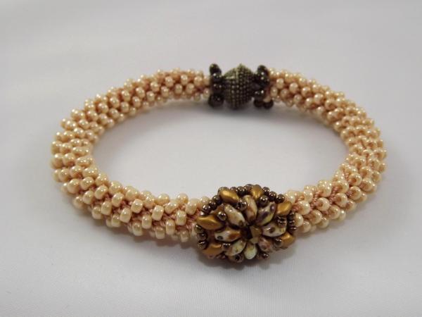 B-31 ecru crocheted rope bracelet with flower slide