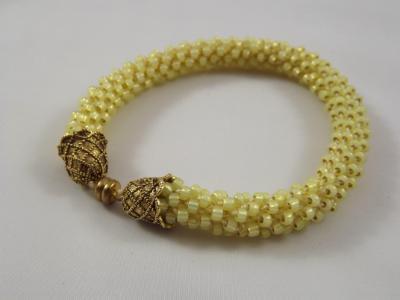 B-7 pale yellow crocheted rope bracelet